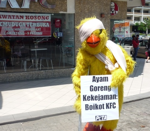 PETA Rocks KFC Malaysia With Grim Reapers, Caged Activists, and a Crippled Chicken