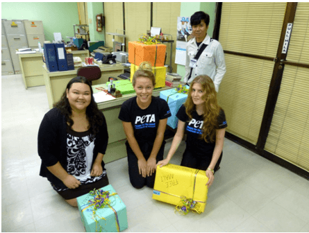 Josceline Cluff (holding the yellow box), fellow intern Milena König (kneeling, center), and PETA staff members Jana Sevilla (left) and Xavier Emas deliver thousands of letters and pictures from students to the Office of the President in support of PETA's campaign to free Mali, the elephant at the Manila Zoo.