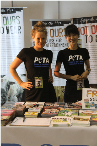 Olivia and fellow intern Fern Tan work behind the information table at a Morrissey concert in Manila.
