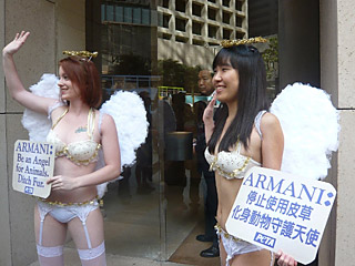 An intern joins a PETA staffer in a protest against Armani's use of fur.