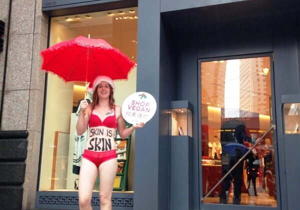 Activist Dresses in Sexy Ho-Ho-Holiday Outfit With 'Skin Is Skin' Message