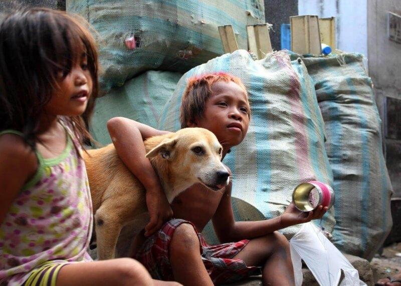 These kids love their dog, Pochi, who was spayed through our KLIP program.