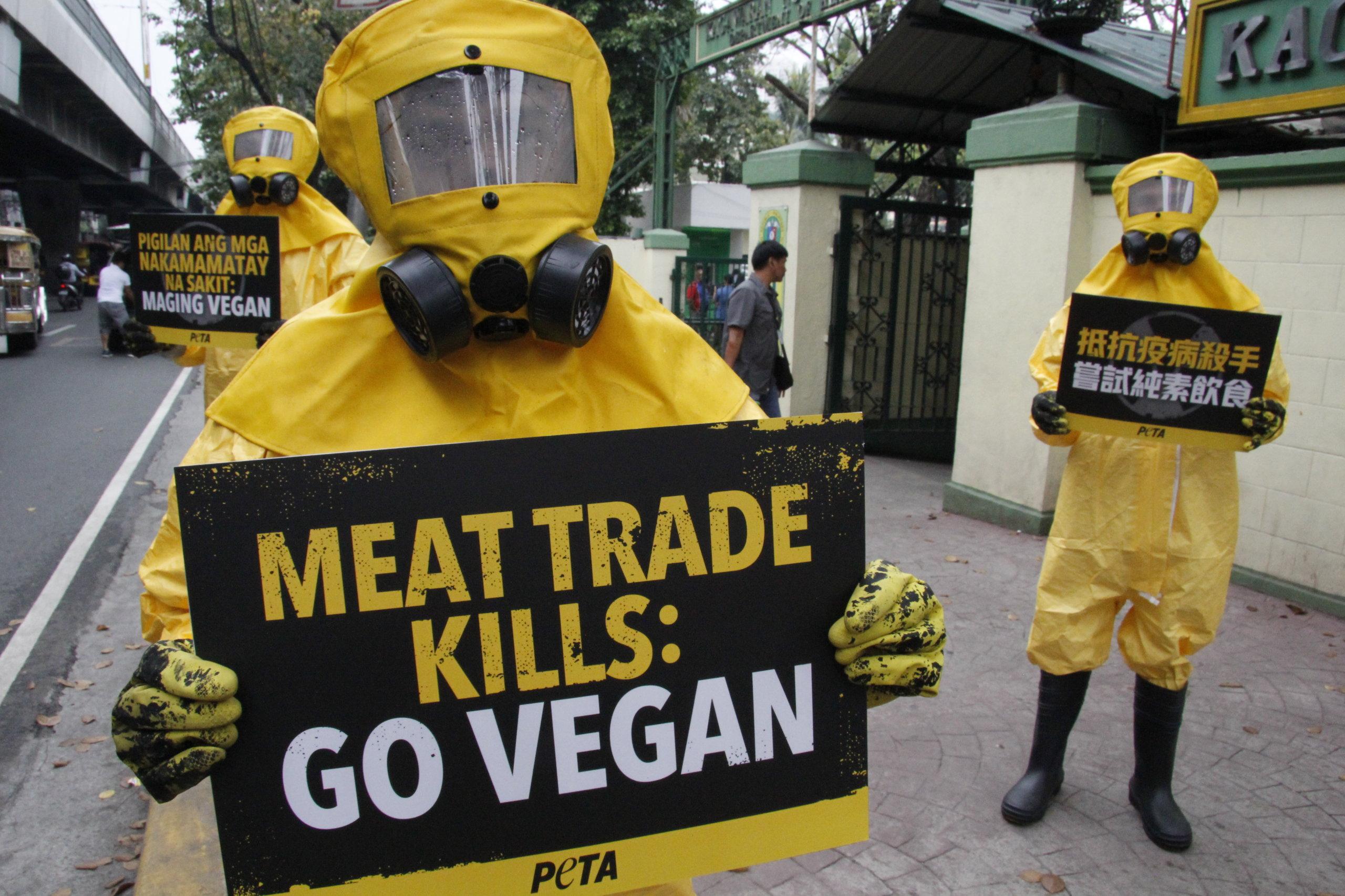 Photos: PETA Members Dressed Hazmat Suits Blame Meat Industry for Coronavirus